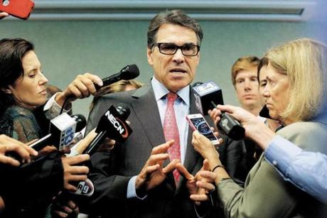 Governor Rick Perry of Texas, a possible Republican contender for the 2016 presidential race, answered reporters questions after an appearance at a luncheon in Portsmouth, N.H.